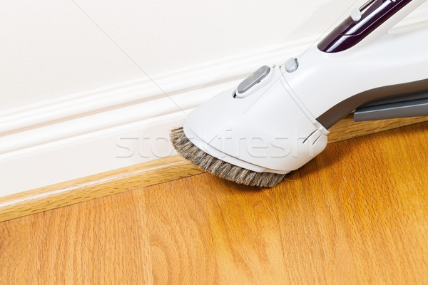 Cleaning Floor and Trim work with Vacuum Cleaner  Stock photo © tab62