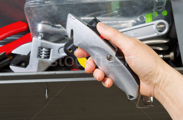 Hand taking out Box Cutter from toolbox  Stock photo © tab62