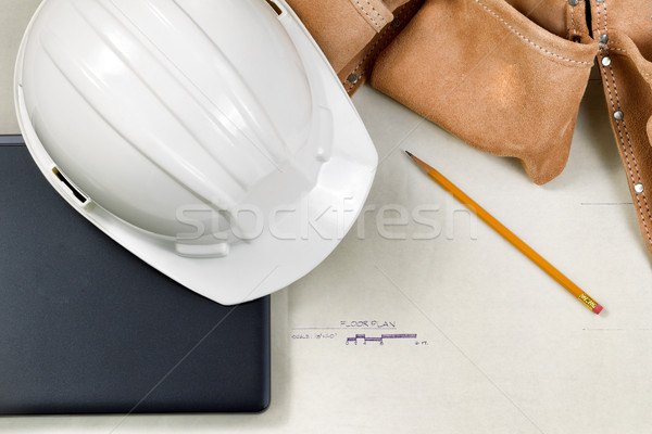 Construction contractor tools resting on top of blue print CAD d Stock photo © tab62