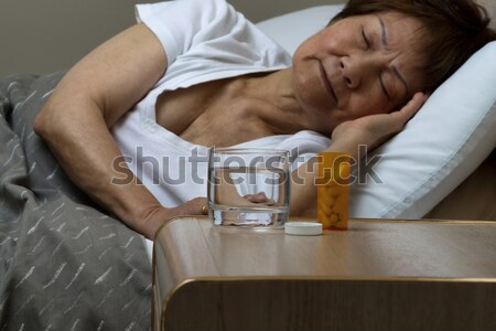 Depressed mature man with medicine and gun  Stock photo © tab62