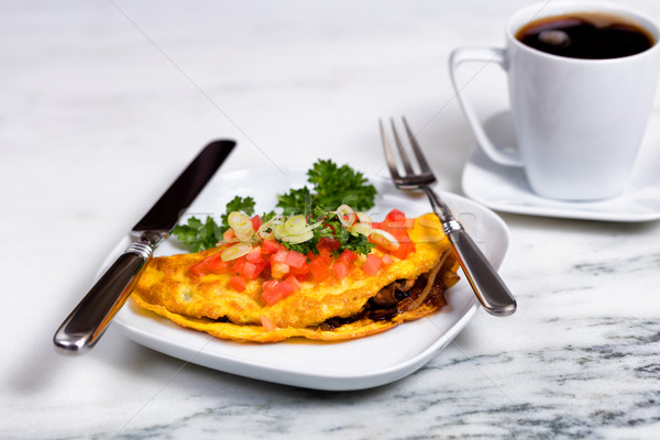 Fresh egg omelet topped with vegetables and coffee for breakfast Stock photo © tab62
