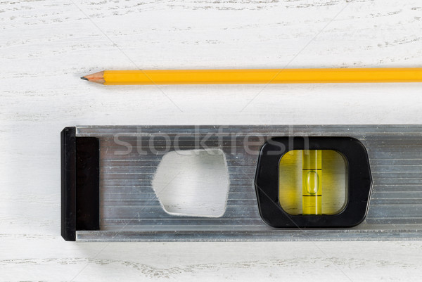 Level tool with pencil on wooden boards Stock photo © tab62