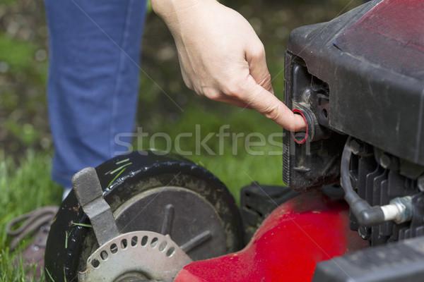 Preparing to start gas lawnmower Stock photo © tab62