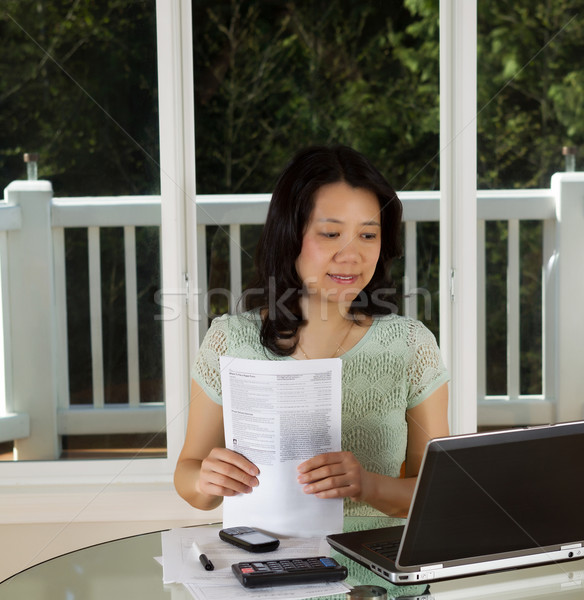 Mature woman working at home office with tax forms  Stock photo © tab62