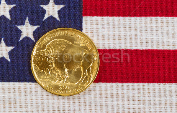 Fine gold Buffalo Coin on USA flag background Stock photo © tab62