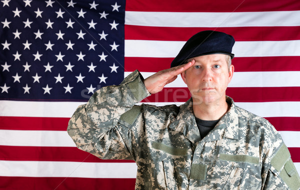 Veteran solider saluting with USA flag in background  Stock photo © tab62