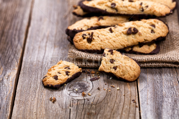 Homemade chocolate chip cookies in linen napkin on rustic wood Stock photo © tab62
