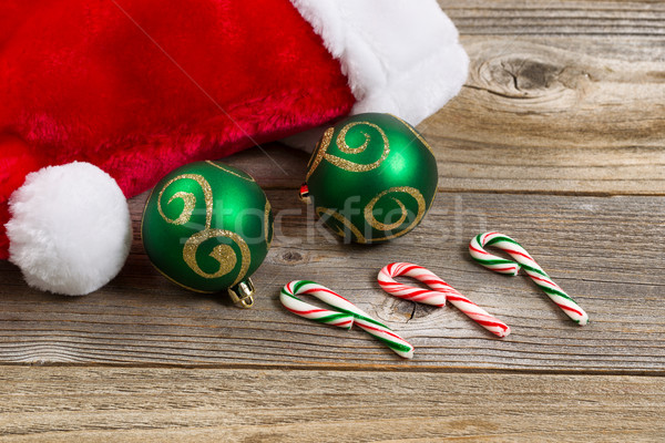 Santa cap with holiday ornaments on wooden boards Stock photo © tab62