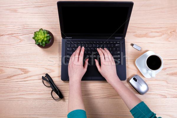 Office desktop setup with female hands working on laptop keyboar Stock photo © tab62