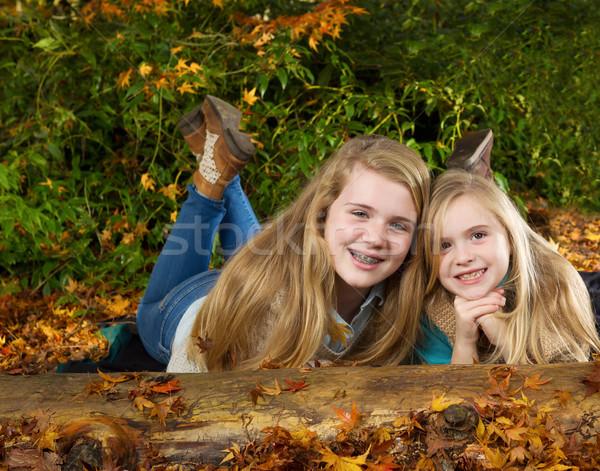 Sisters Having fun on an Autumn Day  Stock photo © tab62