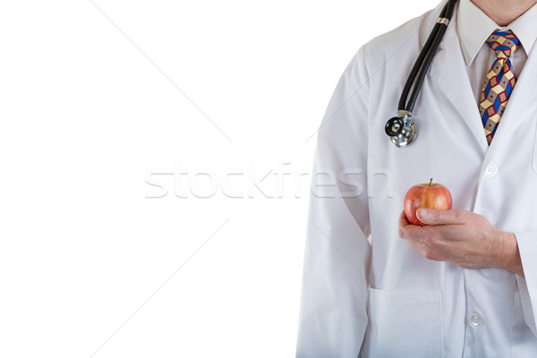 Partial front view of doctor holding apple on white background Stock photo © tab62