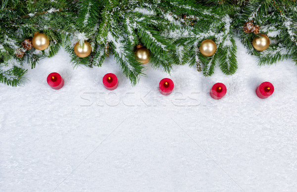 Red burning candles and Christmas objects covered with fresh sno Stock photo © tab62