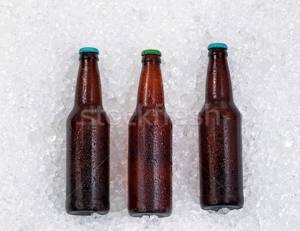 Bottles of beer being chilled on pile of ice  Stock photo © tab62