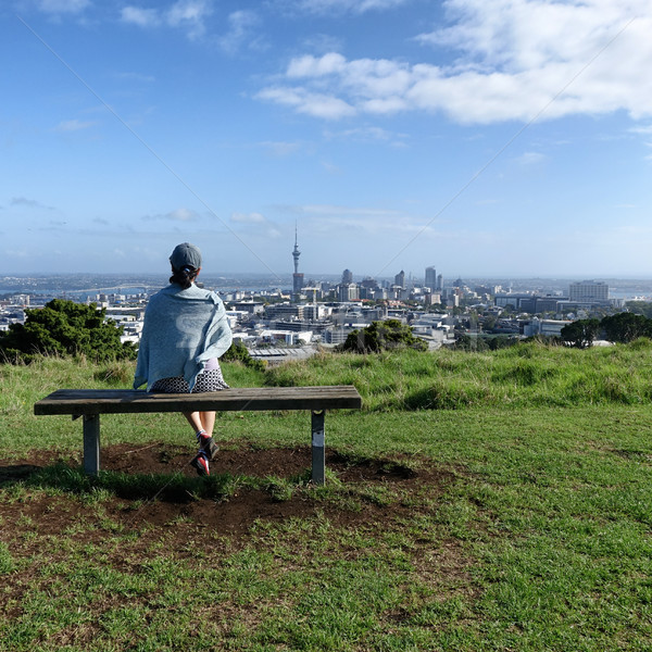 Woman sitting on bench will looking at skyline of Auckland  Stock photo © tab62