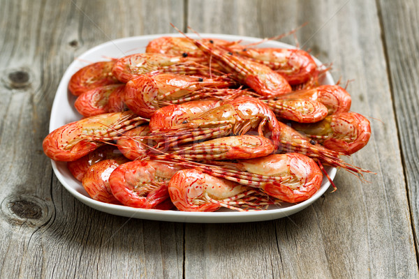 Fresh Steamed Shrimp in White Plate with rustic wood  Stock photo © tab62