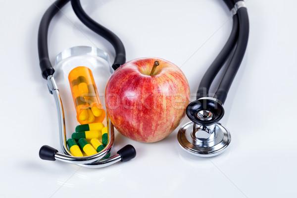 Medicina manzana roja cápsulas estetoscopio Foto stock © tab62