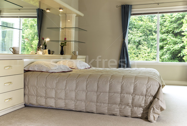 Master Bedroom with Large Window displaying Green Trees in backg Stock photo © tab62