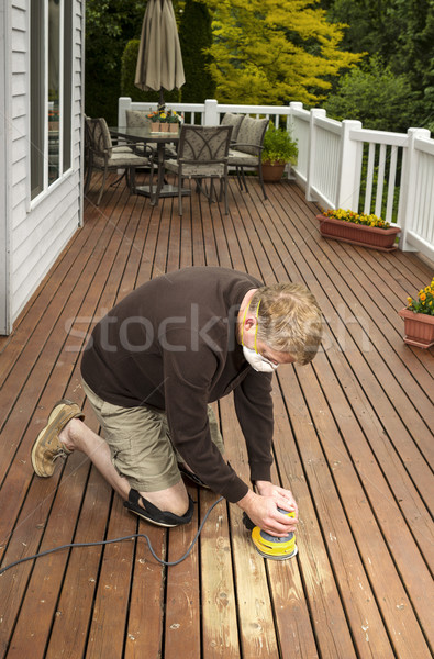 Mature man working on Natural Cedar Deck  Stock photo © tab62