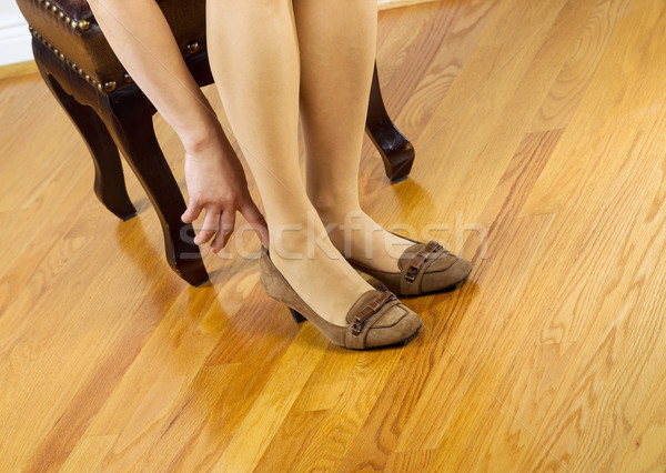 Woman in stockings putting on shoes  Stock photo © tab62