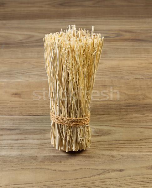 Tied bundle of straw on rustic wood  Stock photo © tab62