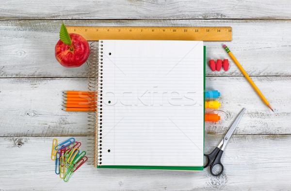 фундаментальный школьные принадлежности яблоко белый столе Сток-фото © tab62
