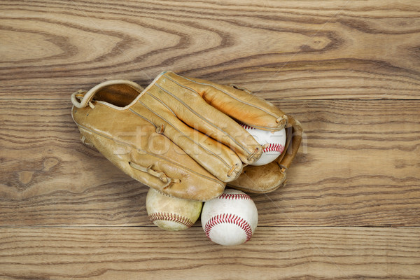Old Baseball Gear on aged wood  Stock photo © tab62