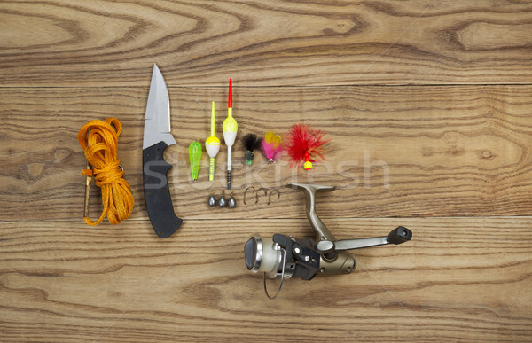 Fishing Kit with assorted equipment on aged wood  Stock photo © tab62