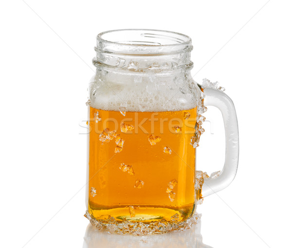 Jar glass filled with ice cold amber beer on white background  Stock photo © tab62