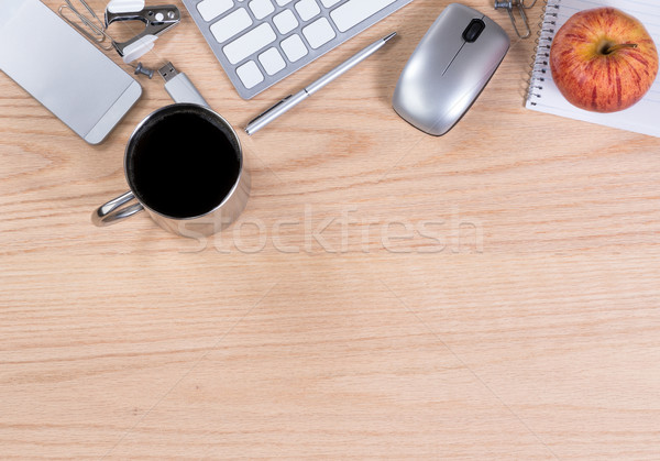 Oak wooden desktop with various office equipment on upper border Stock photo © tab62