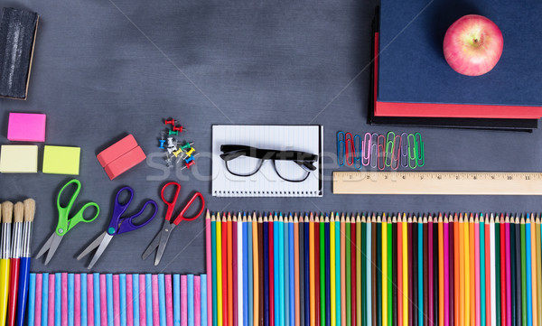 Back to school supplies placed on erased black chalkboard   Stock photo © tab62