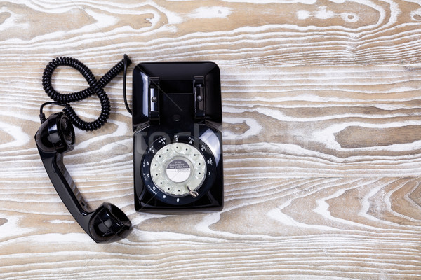 Retro telephone on faded wooden surface Stock photo © tab62
