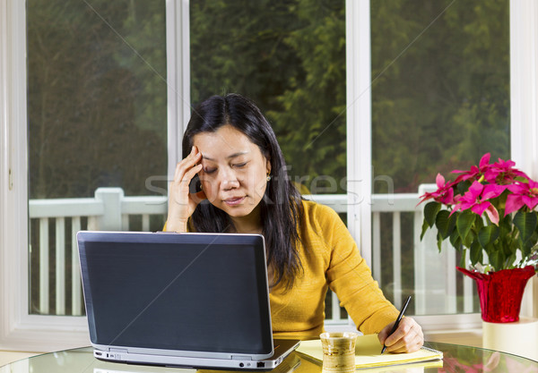 Mature woman stressed while working at Home  Stock photo © tab62