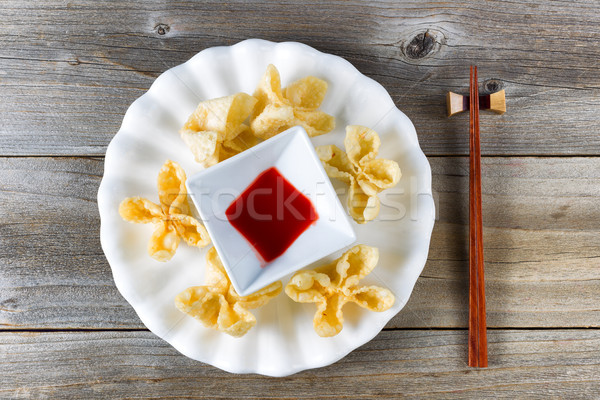 Fried wanton shells and sweet dipping sauce in white bowl on rus Stock photo © tab62