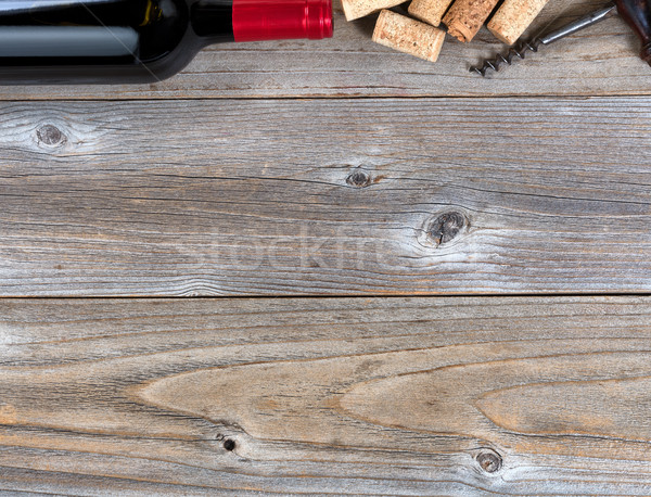 Top border of a bottle of red wine with vintage corkscrew and us Stock photo © tab62