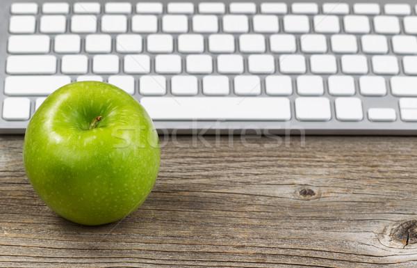 Healthy green apple with keyboard on rustic wooden desktop Stock photo © tab62