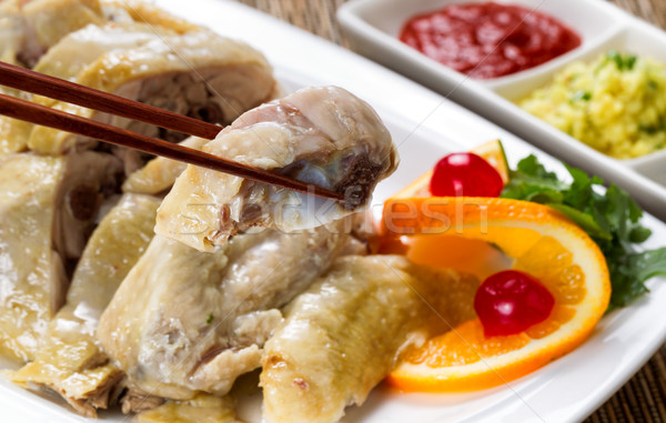 Sliced chicken and dipping sauces on white serving plate ready t Stock photo © tab62