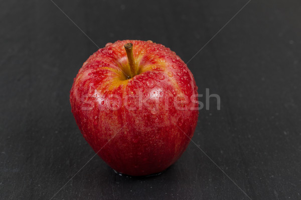Fresh red whole apple on black slate stone background  Stock photo © tab62