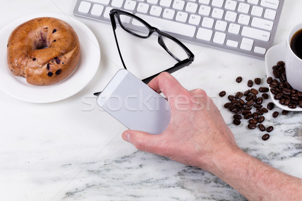 Preparing to answer phone while working at home on white marble  Stock photo © tab62