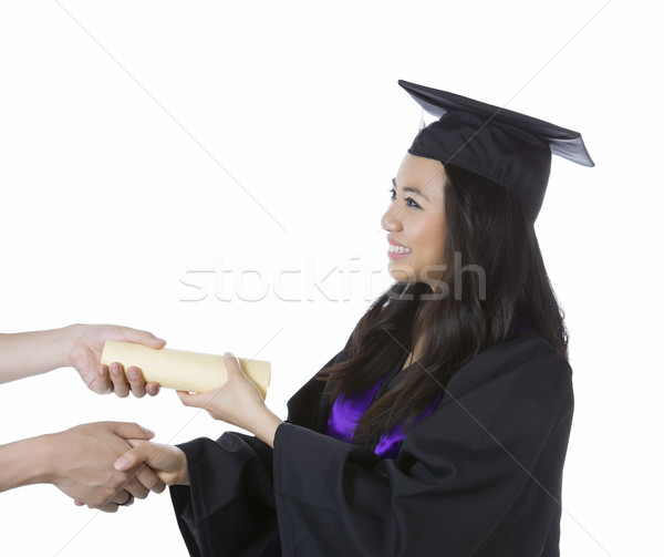 Stock photo: Young Adult Woman Receiving her Diploma while Graduating