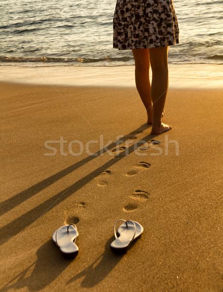 Woman walking on beach into ocean Stock photo © tab62