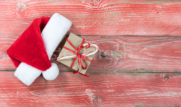Holiday gift box with Santa cap on rustic red wooden boards  Stock photo © tab62