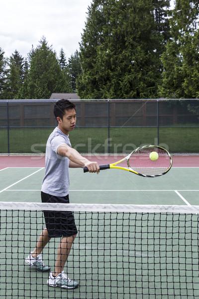 Tênis vôlei jovem asiático homem ao ar livre Foto stock © tab62