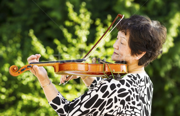 Senior woman performing music outdoors  Stock photo © tab62