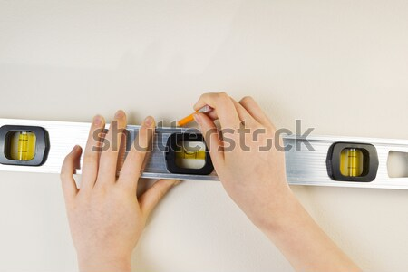 Using Stud Finder on interior home wall  Stock photo © tab62