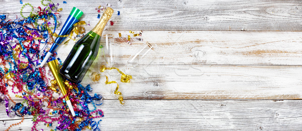 New Year party decorations and champagne on rustic white wood Stock photo © tab62