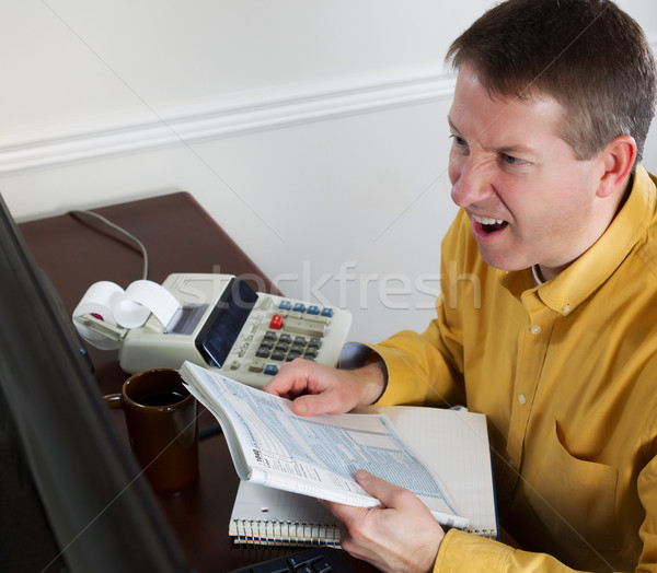 Mature Man goes into rage while work on his Taxes  Stock photo © tab62