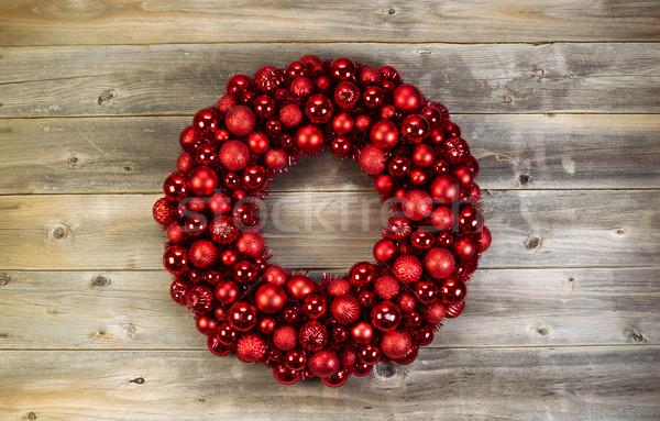 Large Christmas Wreath on Faded Wood Stock photo © tab62