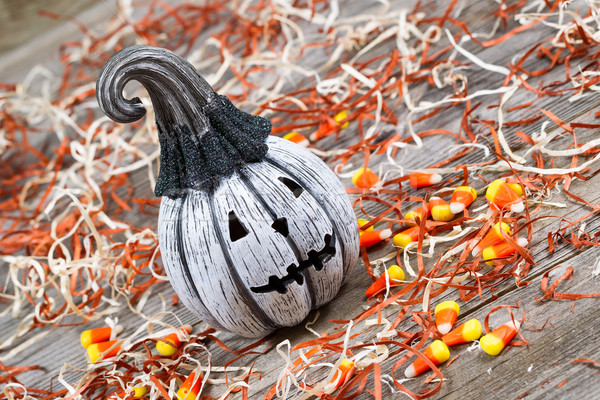 Angled scary black and white Halloween pumpkin on rustic wood   Stock photo © tab62