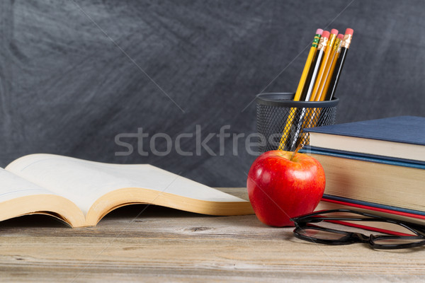 Desktop with reading materials and blackboard  Stock photo © tab62