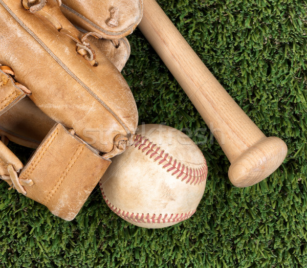 Close up overhead view of old baseball equipment on grass Stock photo © tab62